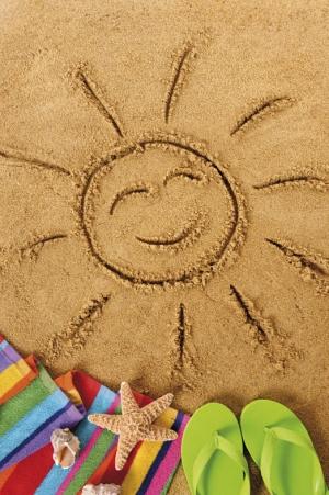 soleil dessiné sur le sable